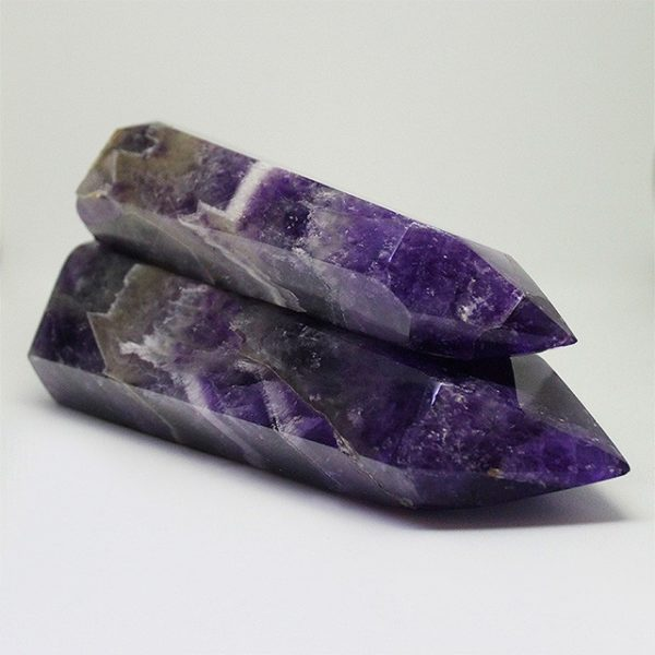 a photo of two amethyst towers