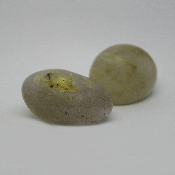 a photo of rutlilated quartz palm stones