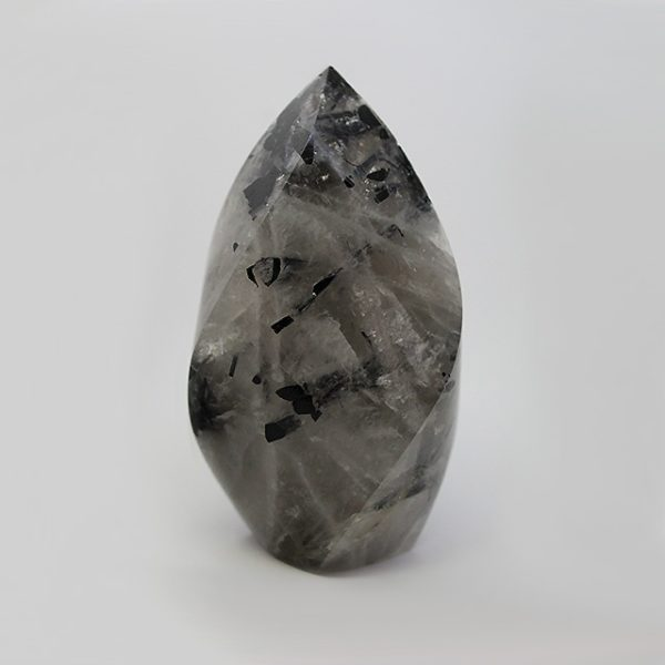 a photo of a small tourmalinated quartz flame
