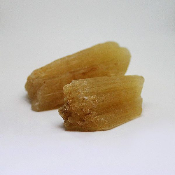 a photo of yellow calcite freeforms