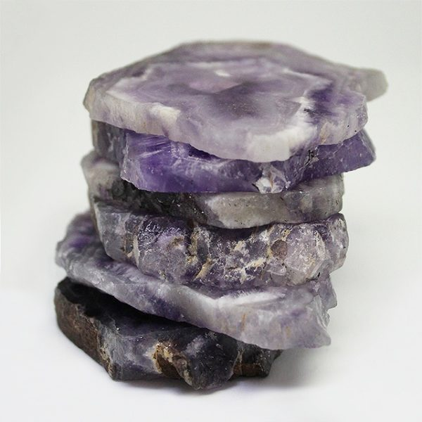 a photo of amethyst slices laid on top of each other