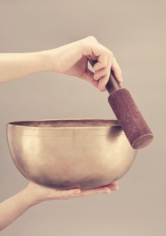 cleansing crystals with a singing bowl