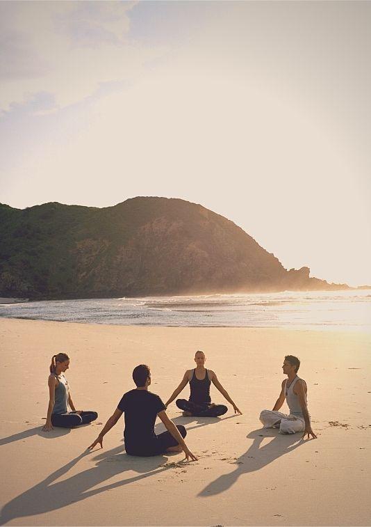 group meditation on the beach