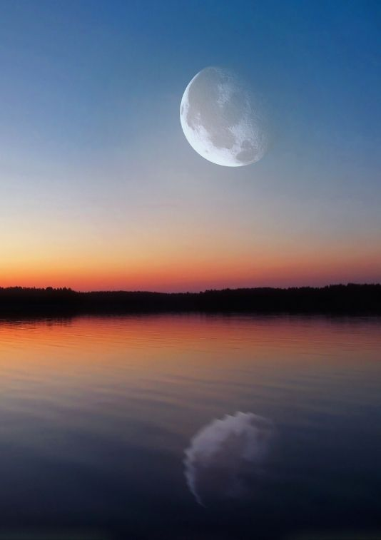 photo of the moon reflected on water