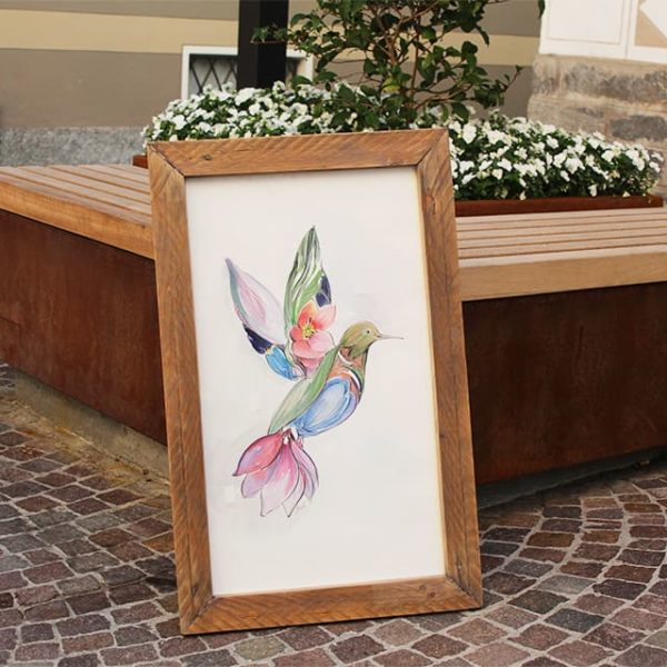 a photo of a water coloured painting by Mali. This one is called Hummingbird with body made of flowers