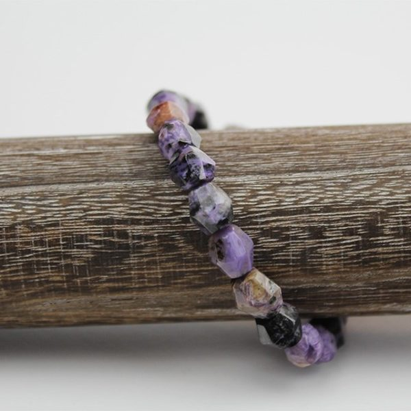 a photo of a charoite bracelet