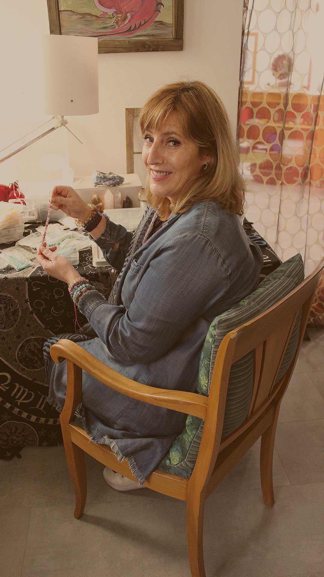 A photo of Catherine Regan making bracelets