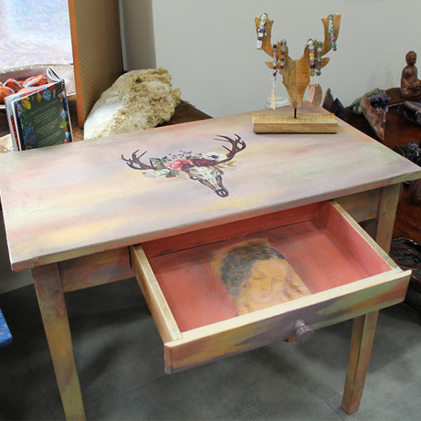 a photo of a multicolor forties table with painting inside drawer upcycled by Mali