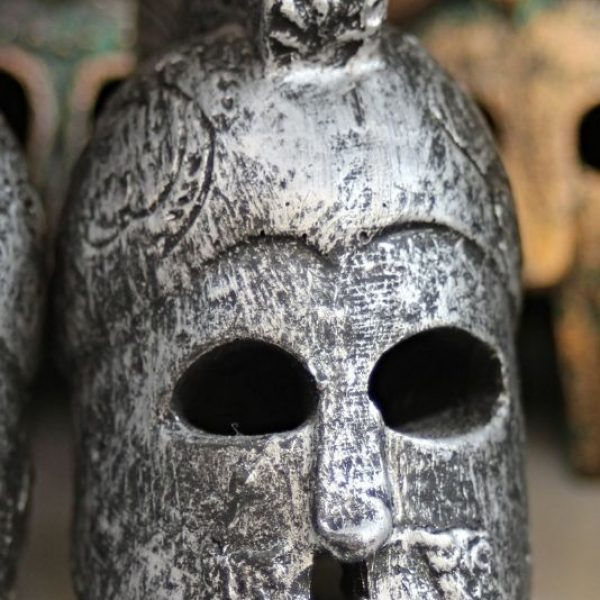 The photo shows the helmet of a Greek warrior